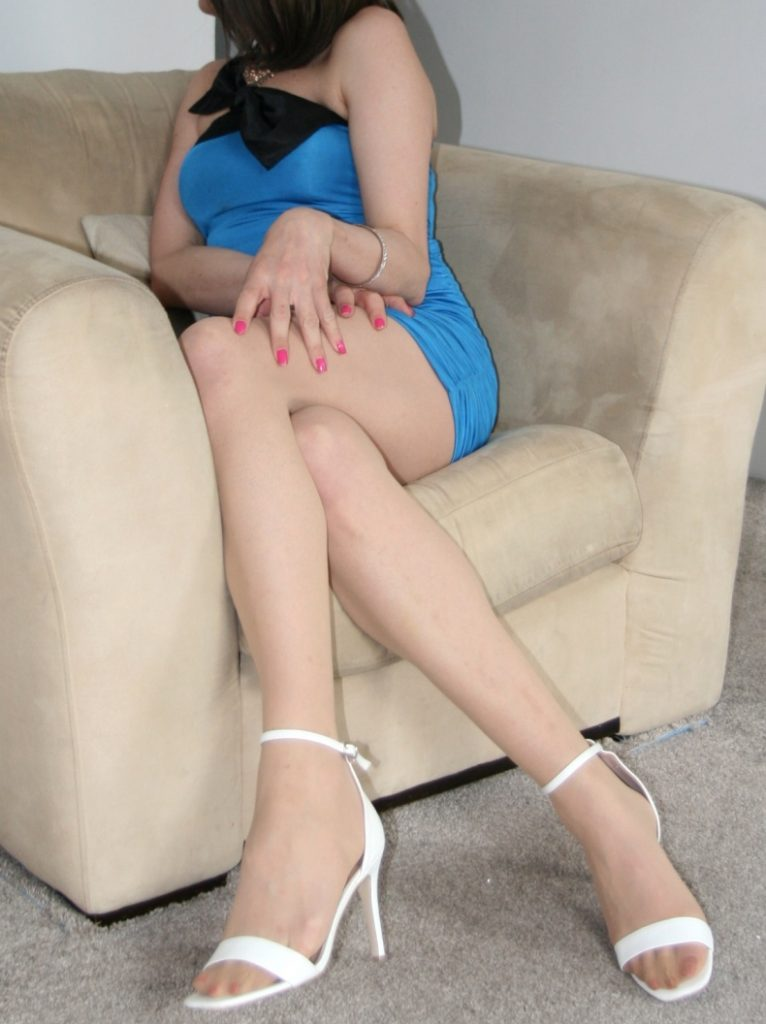 Cross-dressing sissy in tiny blue dress and white stilettos