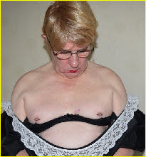 Cross-dressing sissy Chantal shows off his man boobs