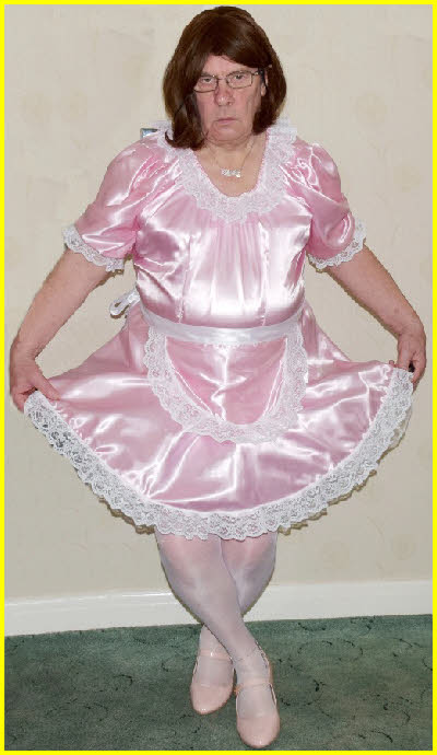 Cross-dressing sissy curtsies in pink French maid uniform