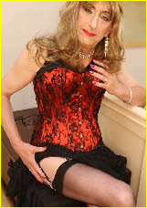Sissy in red corset and black stockings